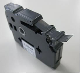 Xử lý băng mực bị bung hoặc kẹt - Brother PT PT9800PCN 1